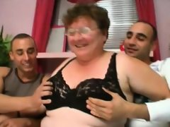 Foxy granny gets hammered by two young..