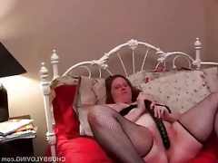 Fat babe inserts a big toy into her..