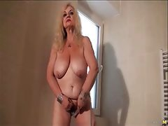 Granny dana strips and masturbates