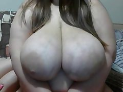 Huge breasts being sucked